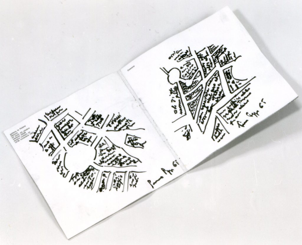 Opened reused foBookpages show sketches of city maps.