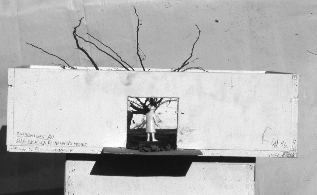 Figure stands in the entrance of quadratic room. Tree roots rise above the walls.