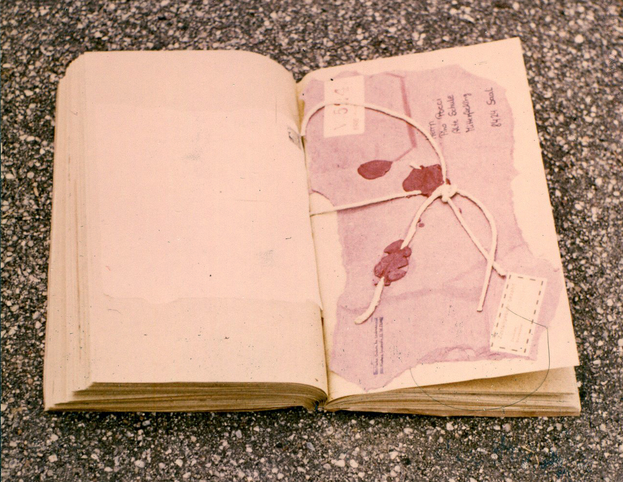 Modified found book - opened – with mixed media collage on page