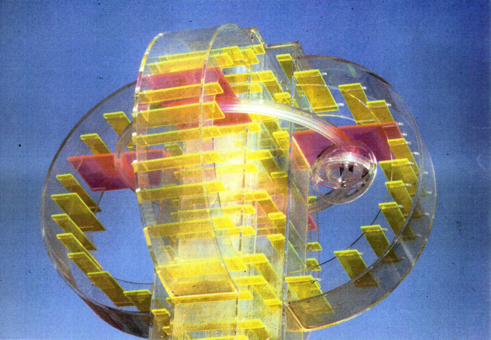 Column made from transparent plexi-glass. Inside bright yellow boards in steady arrangement.