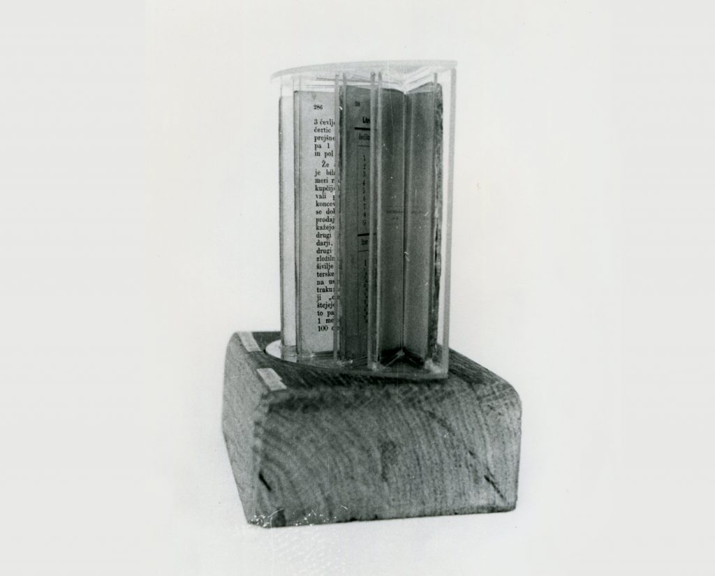 Block of wood with stellar arranged transparent plastic display. Each display contains book pages.