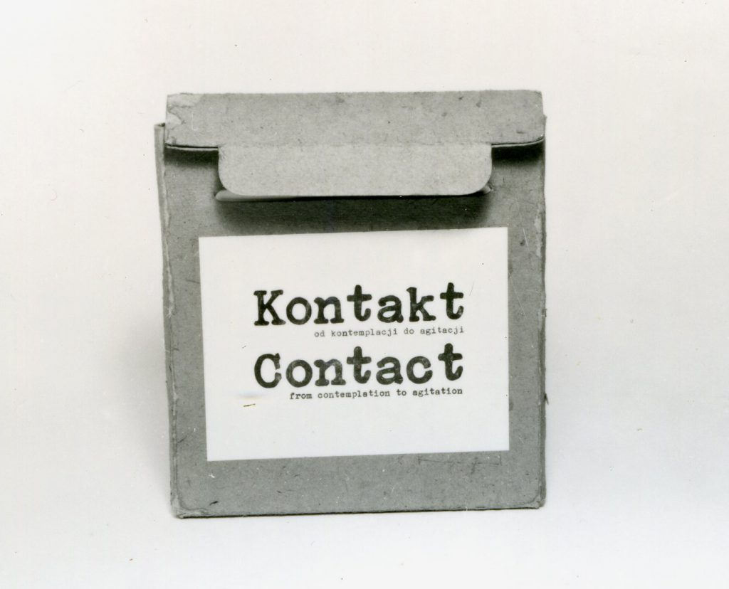 Small cardboard briefcase with sticker.