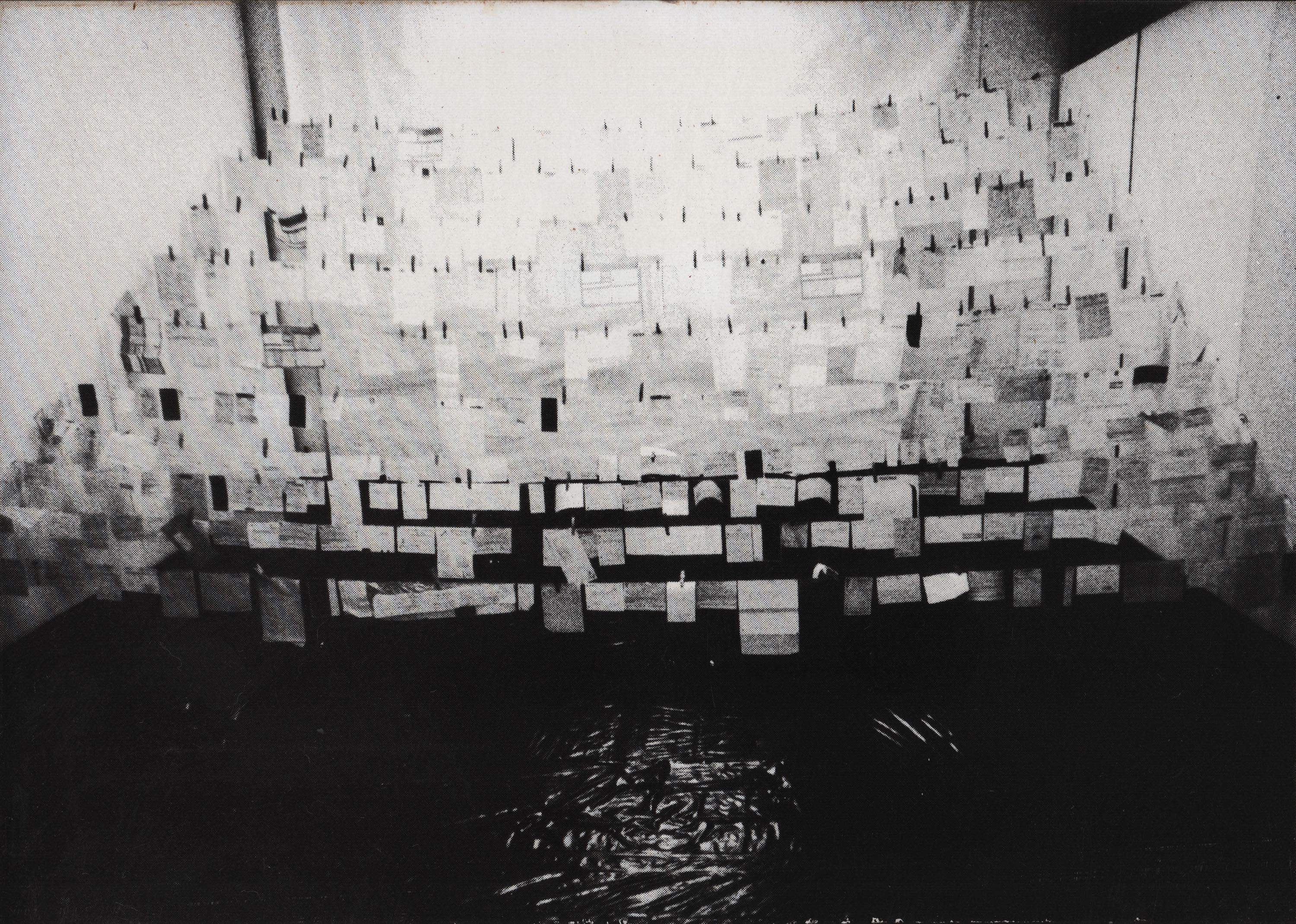 The floor of a room is covered with black plastic bags. Several lines stretch from one side to the other side. Numerous bills hang on the lines.