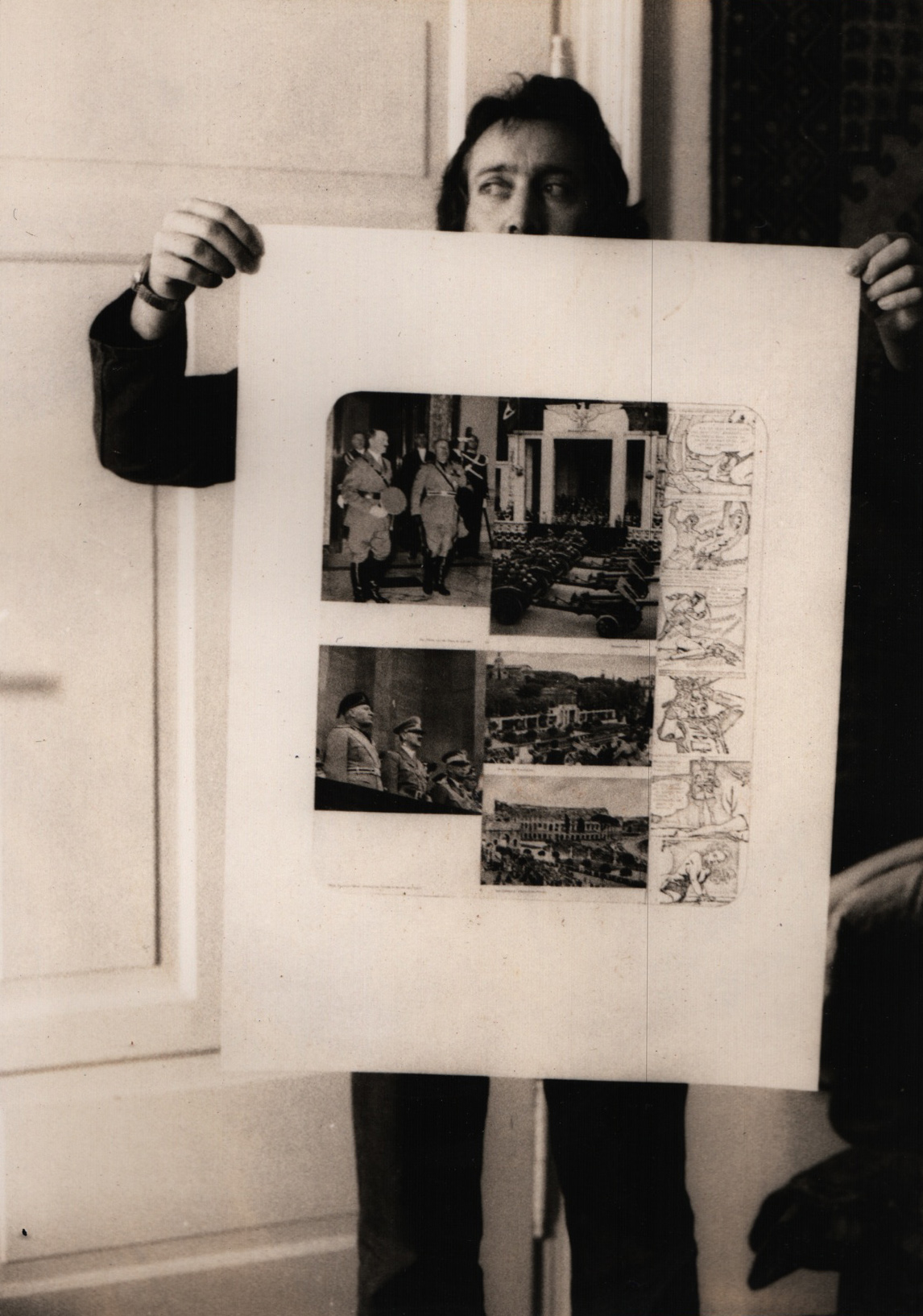 A man holding a huge sheet of paper with collaged photos