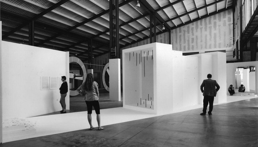A cuboid tunnel inside a hangar.