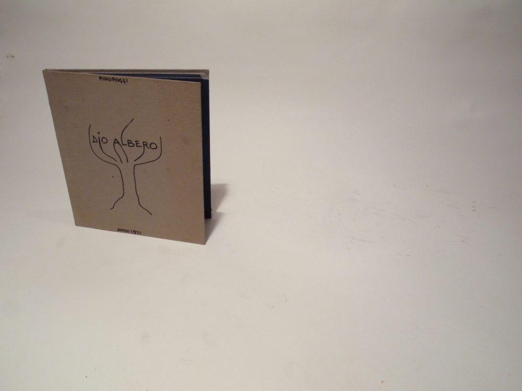 Fanfolded book with carton cover. Cover shows handwritten and drawing of a tree.