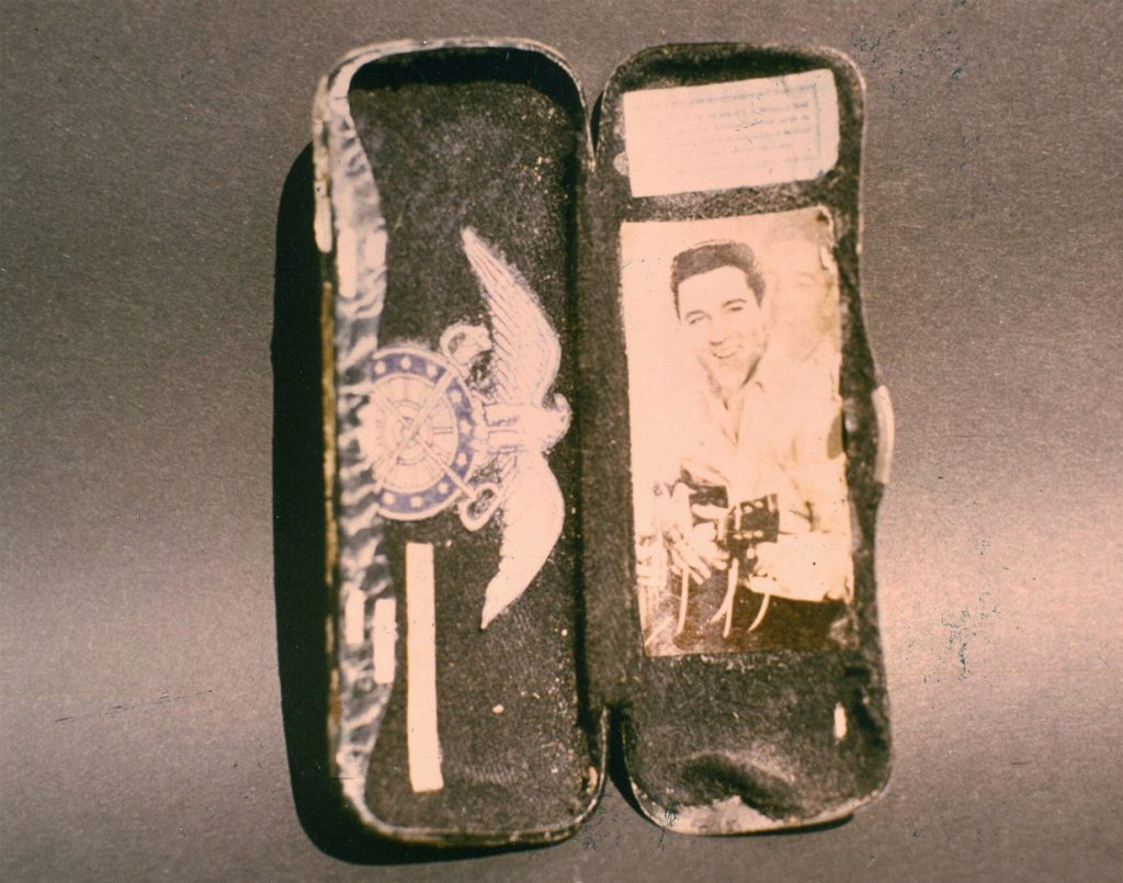 Inside of case with text and image of Elvis attached.