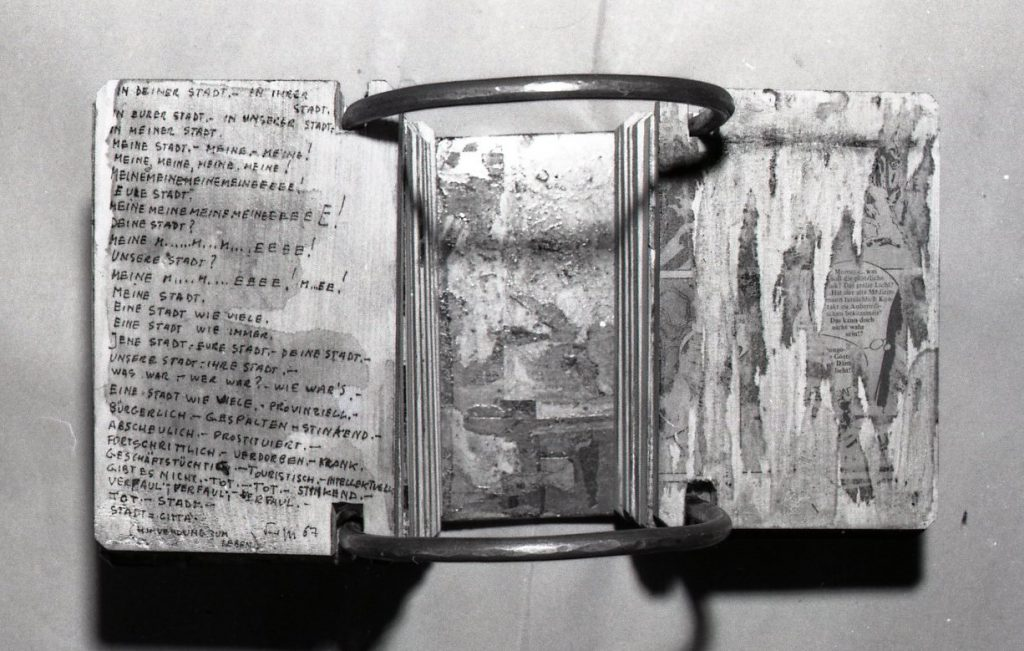 Handwritten poems on stacked wooden panels threaded through holes on metal tube.