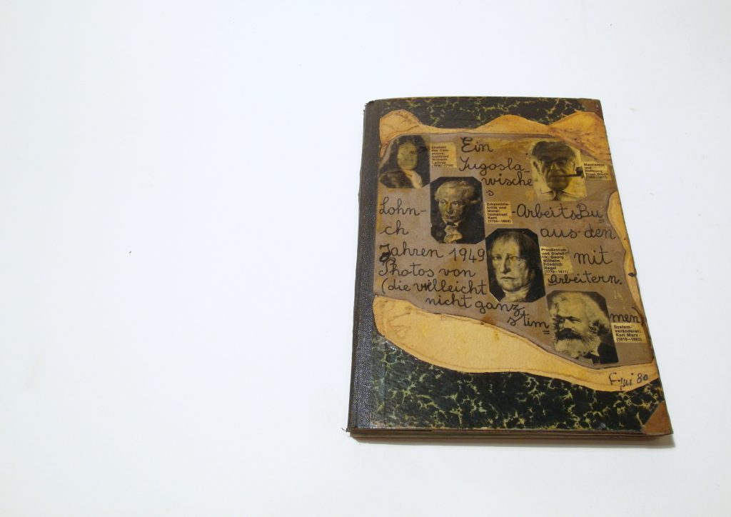 Found note book with handwritten title beside collaged photos of several philosophers.