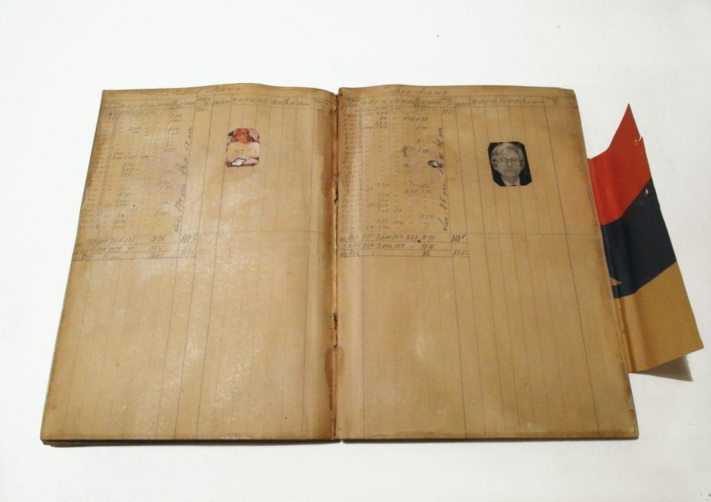 Bookpages show handwritten payroll lists.