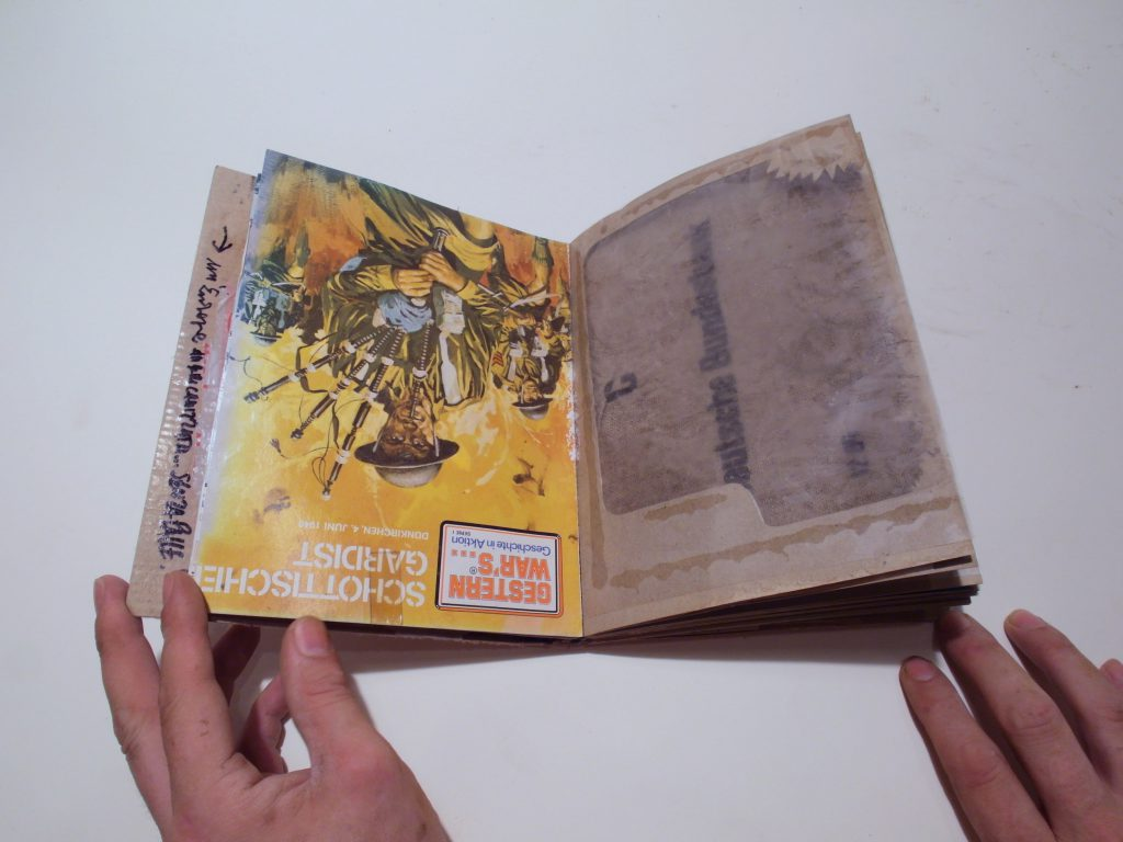 Bookpages made of reused cover from history-magazines about war.