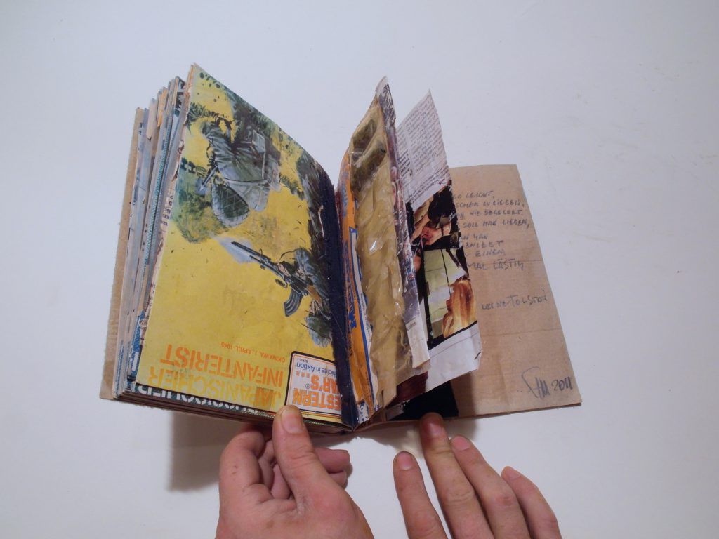 Pages made from packages of military toys.