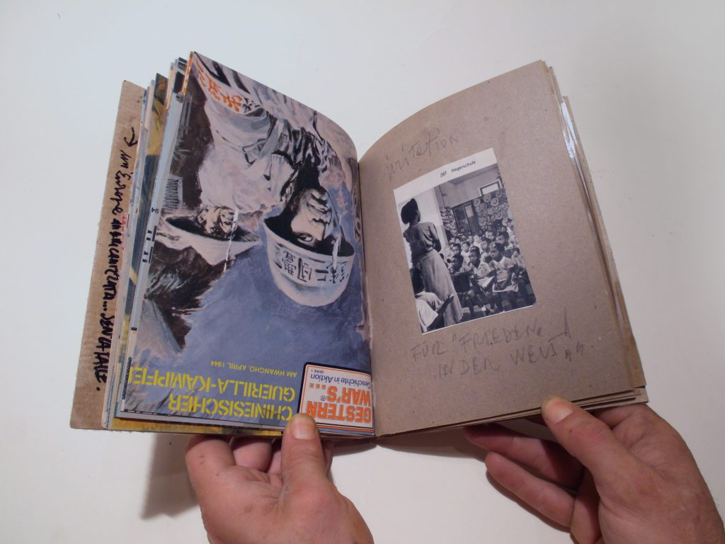 Bookpage made of reused cover from history-magazine. about war. The other page shows handwritten notes and a photo of black kids in school.