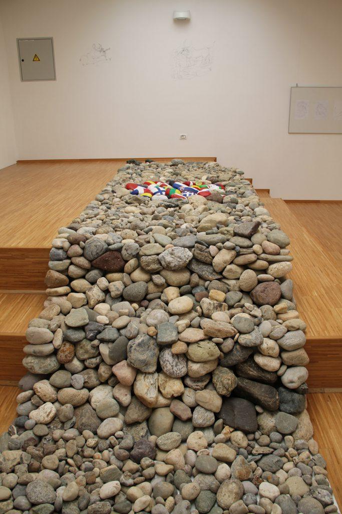 Astrip of stones on the floor extending up a platform.