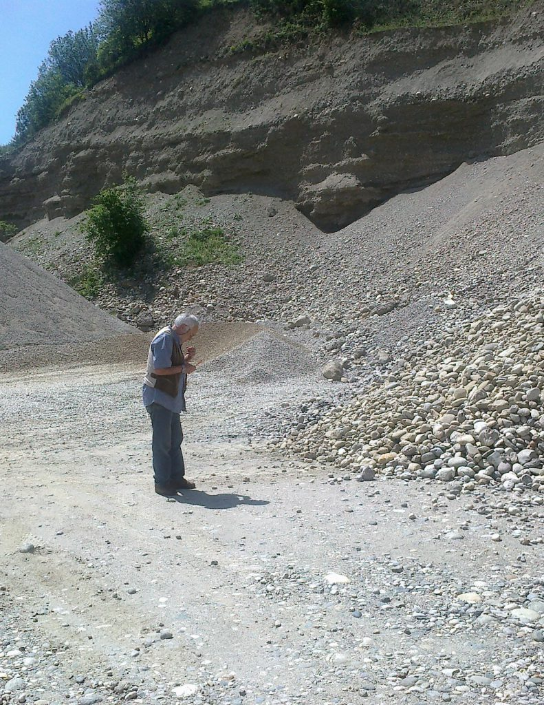 A man in a gravel site.