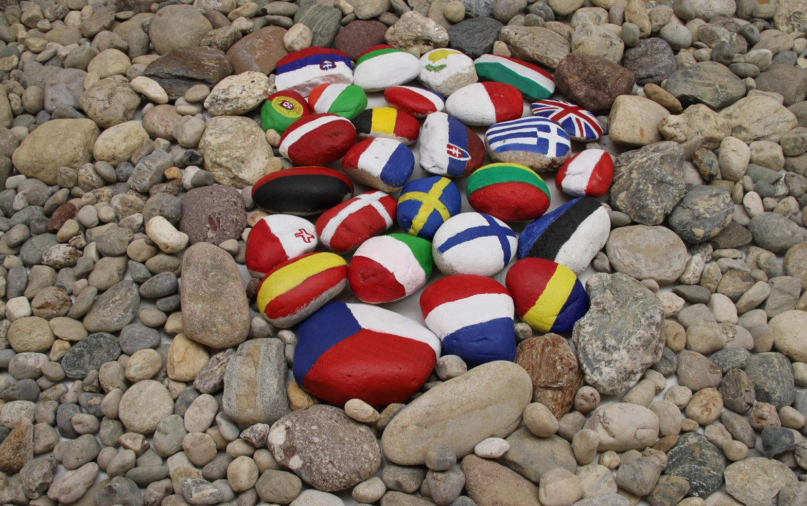 A nest of stones inside the strip. The stones are painted with europen flags.
