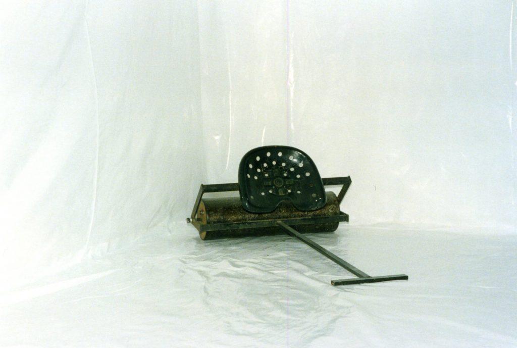 A heavy metal roller in the corner.