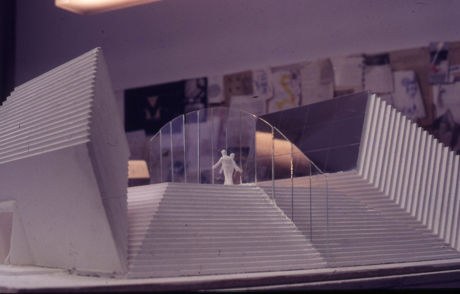 A step pyramid with a flat top. Glas panels divides the pyramind in 2 parts.