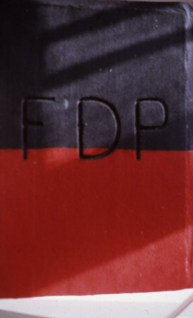 """Red and black book cover with the initials """"FDP""""."""