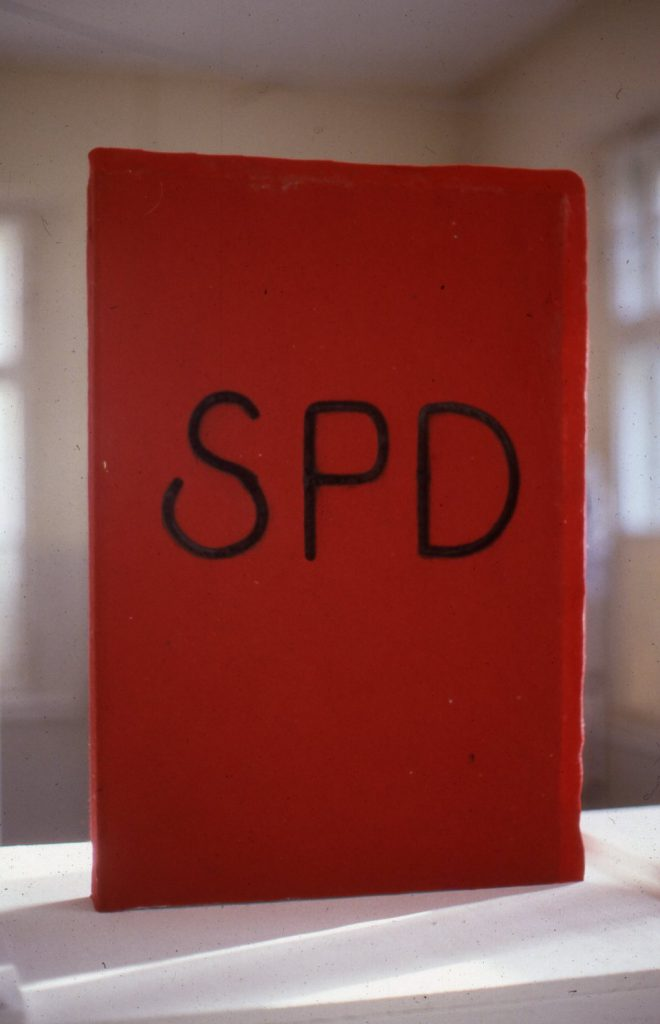"""Red book cover with the initials """"SPD""""."""