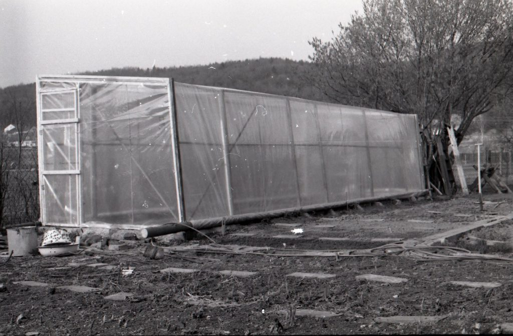 Newly diy built glass house. Around dug up land.