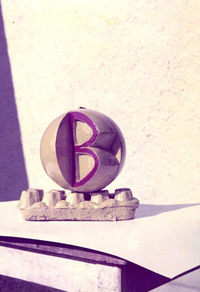 Sculpture model consists of a ball mounted on a base plate.