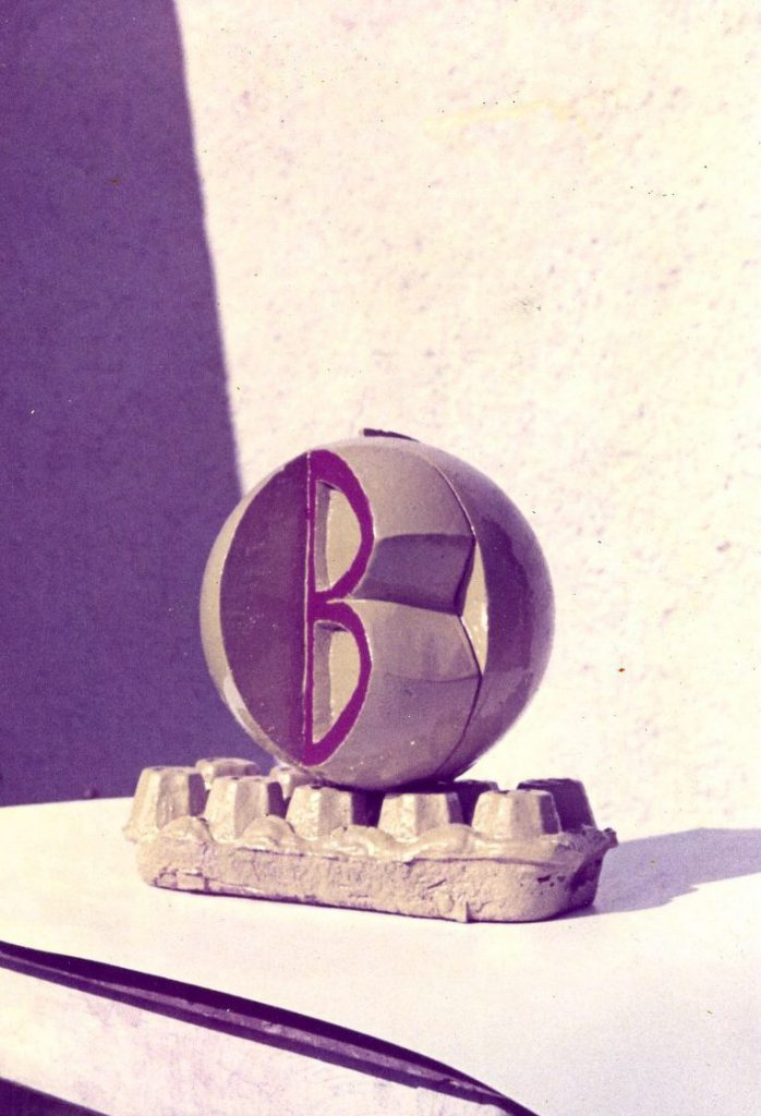 In quarte of the ball the letter B is sculptured.