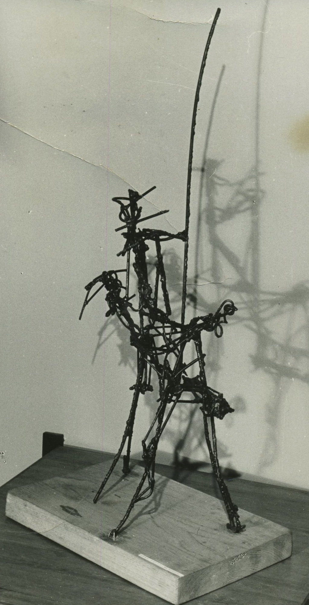 WIre sculpture resembles figure with lance riding a horseback