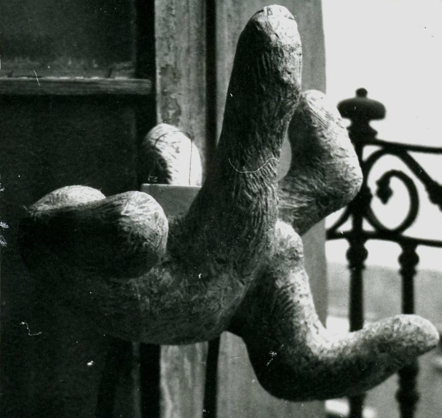 Sculpture of a massive hand.