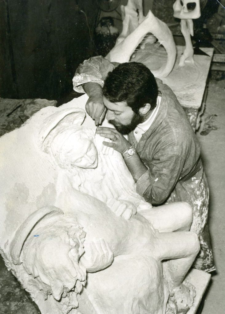 Man sculpturing in studio.