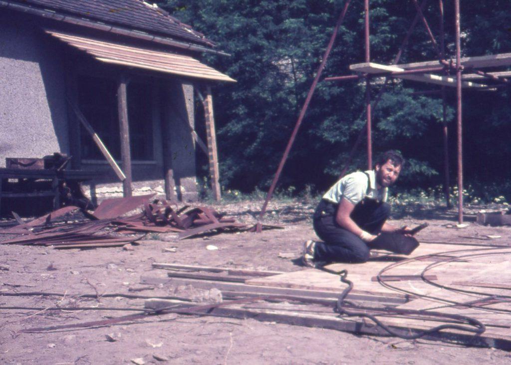 Man working on ground.