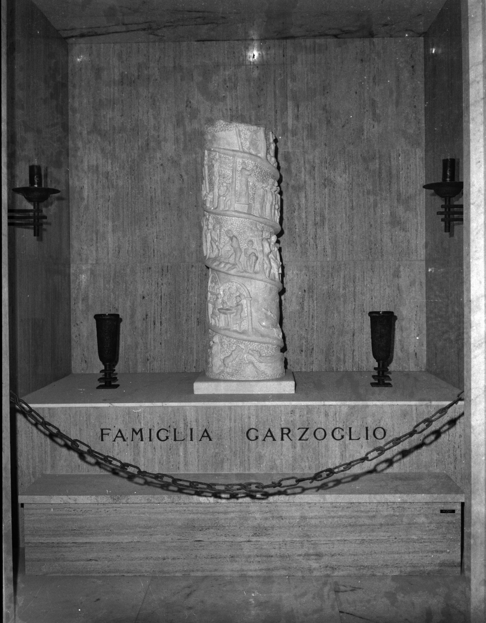 White marble sculpture column standing on a grave.