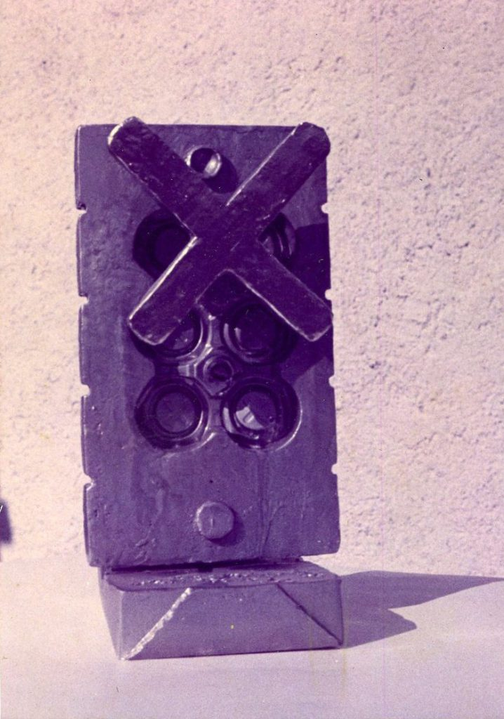 Casting of packaging with X in front.